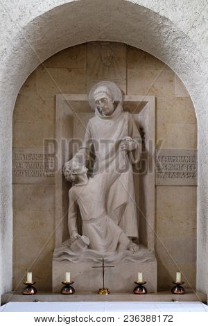 MUNSTERSCHWARZACH, GERMANY - JULY 09: Saint Mauro rescues young Placidus from drowning, altar in Munsterschwarzach Abbey, Benedictine monastery, Germany on July 09, 2017.