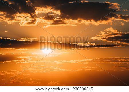 Bright Orange And Yellow Warm Colors Sun In Sunset Sunrise Sky Cloudscape. Sunshine In Dramatic Sky