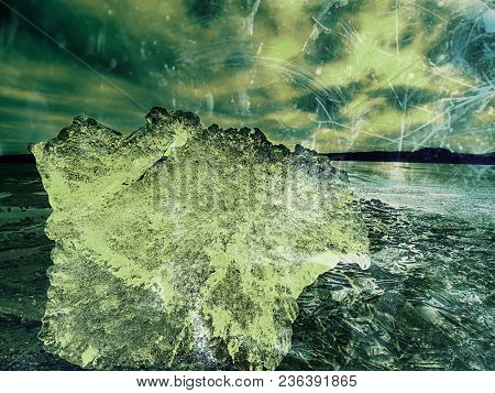 Abstract Effect.  Melting Pieces Of Chopped Ice Blocks. Strong Colorful Backlight Shine Deep Cracks,