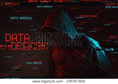 Data Breach Concept With Faceless Hooded Male Person, Low Key Red And Blue Lit Image And Digital Gli
