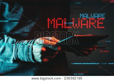 Malware Concept With Person Using Tablet Computer, Low Key Red And Blue Lit Image And Digital Glitch