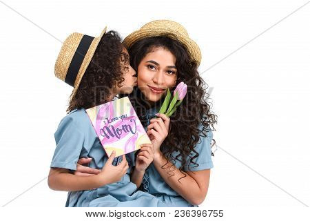 Daughter With Mothers Day Greeting Card And Tulip Kissing Her Mother Isolated On White