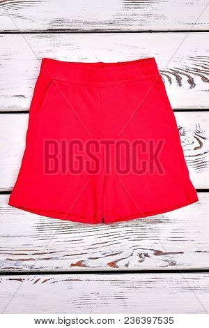 Brightful Brand Shorts For Kids. Red Color Beautiful Cotton Shorts For Childrens, White Wooden Backg