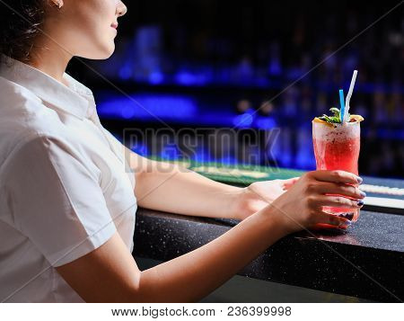 Bar Service. Waitress Holding A Drink At A Restaurant Or Pub Ready To Bring Order To A Customer.