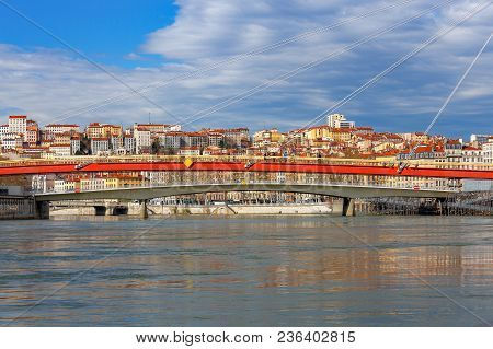 Red Cable-stayed Bridge Over The River Saone. Lyon. France.