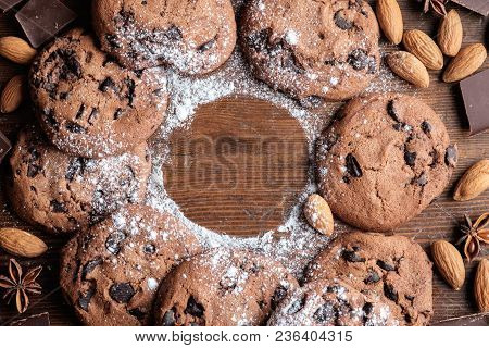 Chocolate Chips Cookies On Dark Rustic Texture With Copy Space For Your Text. Top View.
