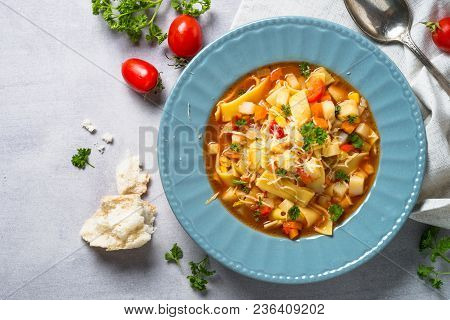Minestrone Traditional Italian Soup From Vegetables, Tomato And Pasta. Meatless Dish. Top View Copy