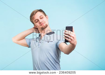 Funny Man Photographing Himself On A Smartphone.