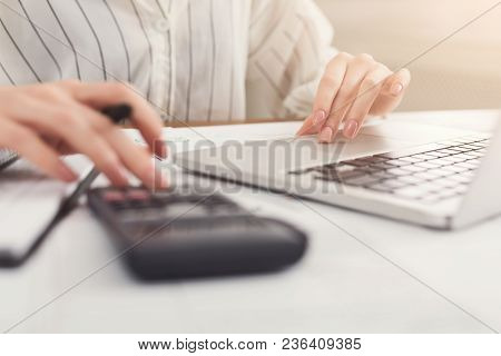 Closeup Of Woman Hands Counting On Calculator And Typing On Laptop. Financial Background, Count And