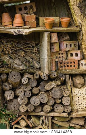 Insect Hotel Or Bug House Made With Old Logs Bricks And Clay Pots To Provide Shelter And A Nesting O