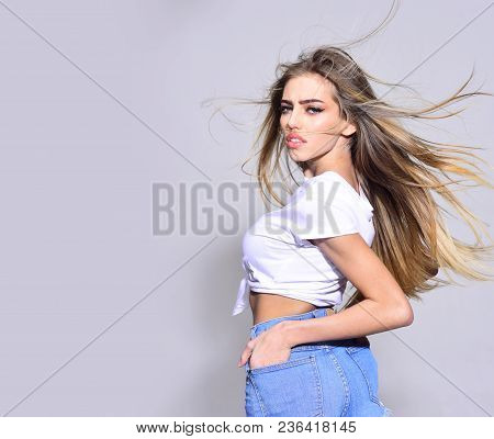 Hair Care Concept. Woman Attractive On Saucy Face Enjoying Her Hair Waving In Air. Lady Sexy With He
