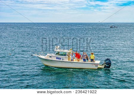 Provincetown, Cape Cod, Massachusetts, Us - August 15, 2017 Boat And His Crew Looking For A Whale.