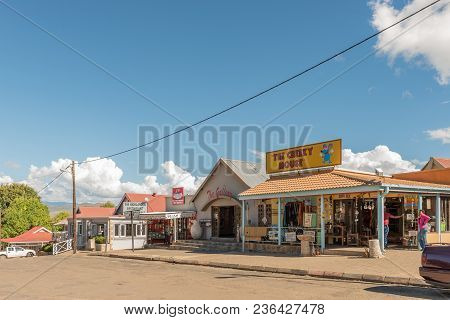 Clarens, South Africa - March 12, 2018: A Street Scene With An Art Gallery, A Restaurant And A Gift