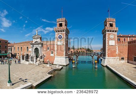 VENICE, ITALY - APRIL 21, 2016: View of small piazza and towers off famous Venetian Arsenal - complex of former shipyards and armories, currently naval base and museum.