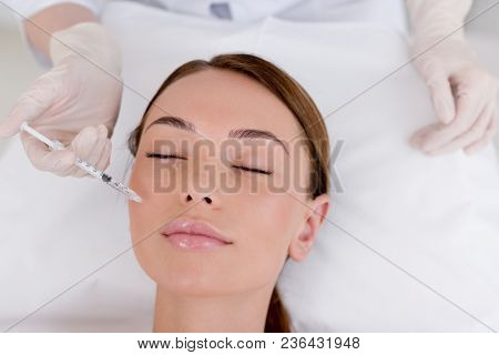 Partial View Of Young Woman Getting Beauty Injection Made By Cosmetologist In Salon