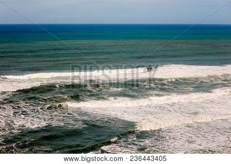Landscape Photo Of Vibrant Blue Sea, With Waves Rolling In, At Santa Cruz, California Usa