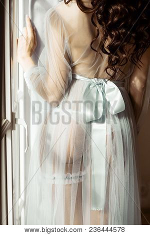 Beautiful Sexy Lady In Elegant Blue Robe. Close Up Fashion Portrait Of Model Indoors. Beauty Brunett