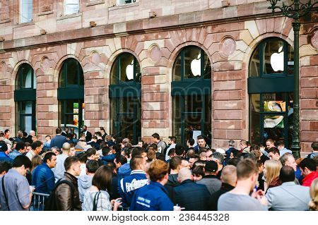 Strasbourg, France - Sep, 19 2014: Young People In Line Queue In Front Of Apple Store With Customers