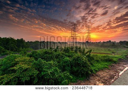 Railroad Against Beautiful Burning Sky At Sunrise. Industrial Landscape With Railroad, Colorful Blue