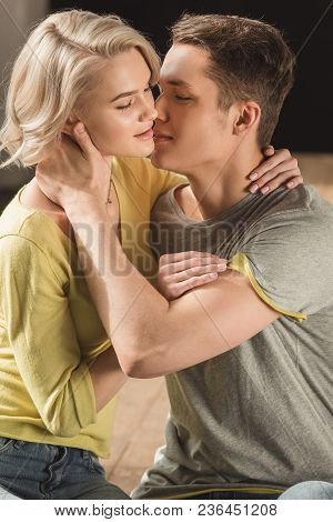 View Of Passionate Boyfriend Kissing Girlfriend At Home