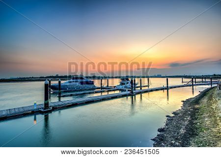 A Long Exposure Picture Of Row Of Luxury Sailboats Reflected In Water, Yacht Port On The Bay, Water
