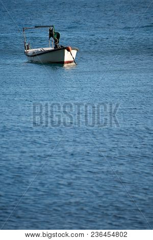 Small Empty Fisherman Boat On The Blue Adriatic Sea Waters On The Coast In Montenegro