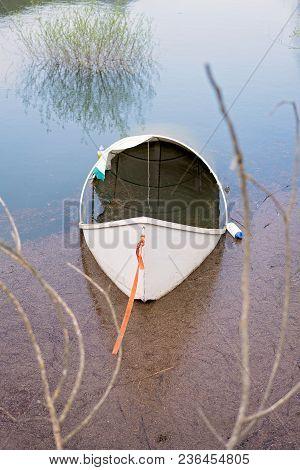 Lonely Empty White Fisherman Boat On The Shore Of Lake Skadar In Virpazar, Montenegro