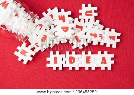 Business Idea, Creativity And Imagination Concept, Abundance White Puzzle Jigsaw With Alphabets Comb
