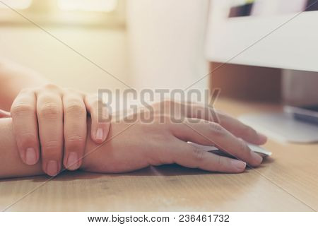 Hand Of A Businessman With A Wrist Injury Of His Own Working A Computer. Office Syndrome Concept