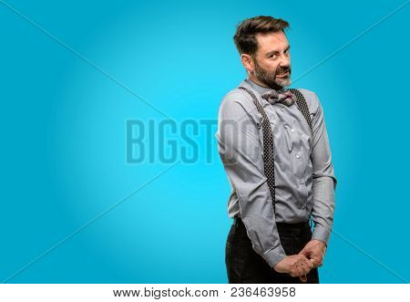 Middle age man, with beard and bow tie angry and stressful frowns face in dissatisfaction, irritated and annoyed, expressing anger