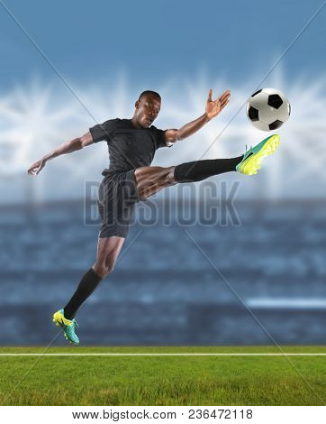 African American soccer player kicking ball during match