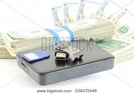 Portable Drive Usb On Stack Of Dollar Bundles For Data Is Money Concept