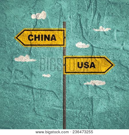 Road Signs With Usa And China Text Pointing In Opposite Directions. Image Relative To Politic Situat
