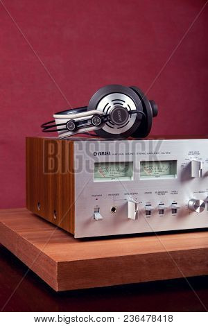 Vintage Stereo Amplifier Frontal Panel with VU meters and Headphones Closeup