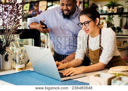 Business owner is using laptop