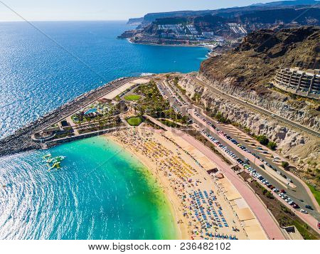 Beautiful Aerial View Of Playa De Amadores Bay With Other Cliffs On The Sea Shore On The Gran Canari