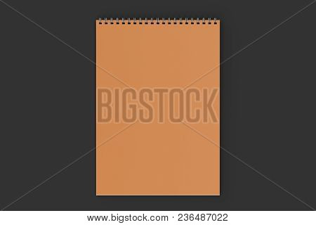 Blank Orange Notebook With Metal Spiral Bound On Black Background