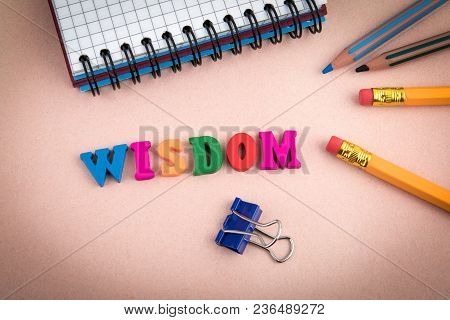 Wisdom. Wooden Letters On The Office Desk, Informative And Communication Background