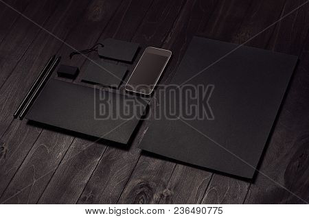 Branding Business Mock Up Of Blank Black Stationery Set With Telephone On Elegant Dark Wooden Backgr