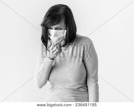 Sick woman wearing surgical mask