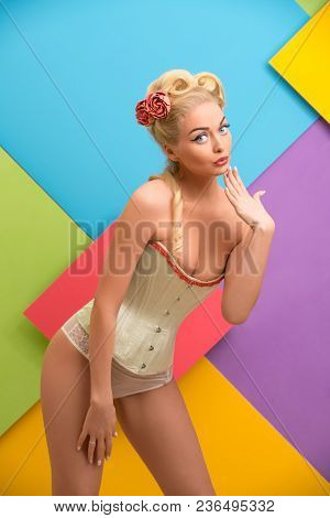 Romantic Sexy Pin Up Girl Wearing Beige Lingerie Cropped Shot Against Colorful Wall