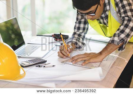 Architect Man Working With Laptop And Blueprints,engineer Inspection In Workplace For Architectural
