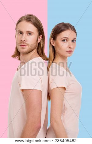 Gender-divided. Pretty Young Woman Standing Against A Blue Background And Her Boyfriend Against A Pi