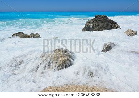 Blue Sky, Perfect Turquoise Water, Group Of Stones Covered With Sea Foam, Greece, Ionian Sea, Lefkad