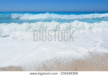 Perfect Turquoise Water, Blue Sky And Big Roling Waves On Famous Kathisma Beach, Lefkada Island, Gre