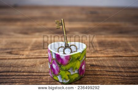 Key In A Giftbox On Wooden Background