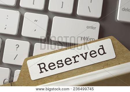 Reserved Concept. Word On Folder Register Of Card Index. Folder Register Lays On Computer Keyboard.
