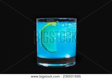 A Single-colored Transparent Cocktail, Refreshing Shining In A Low Blue Glass With Crushed Ice Frapp