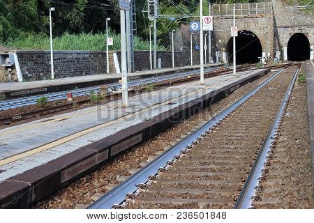 Trailing Rail Running Along The Longitudinal And Tunnel-do Not Cross The Railway Lines