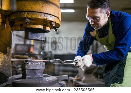 The Man Is Working In The Workshop. Concept - Manual Labor, Male Work